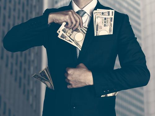 沢山のお金をスーツに入れる人のイメージ画像